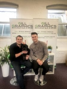Paul Gill, Arlo the office dog and Matt Hobbs at Gill Graphics office in Halifax