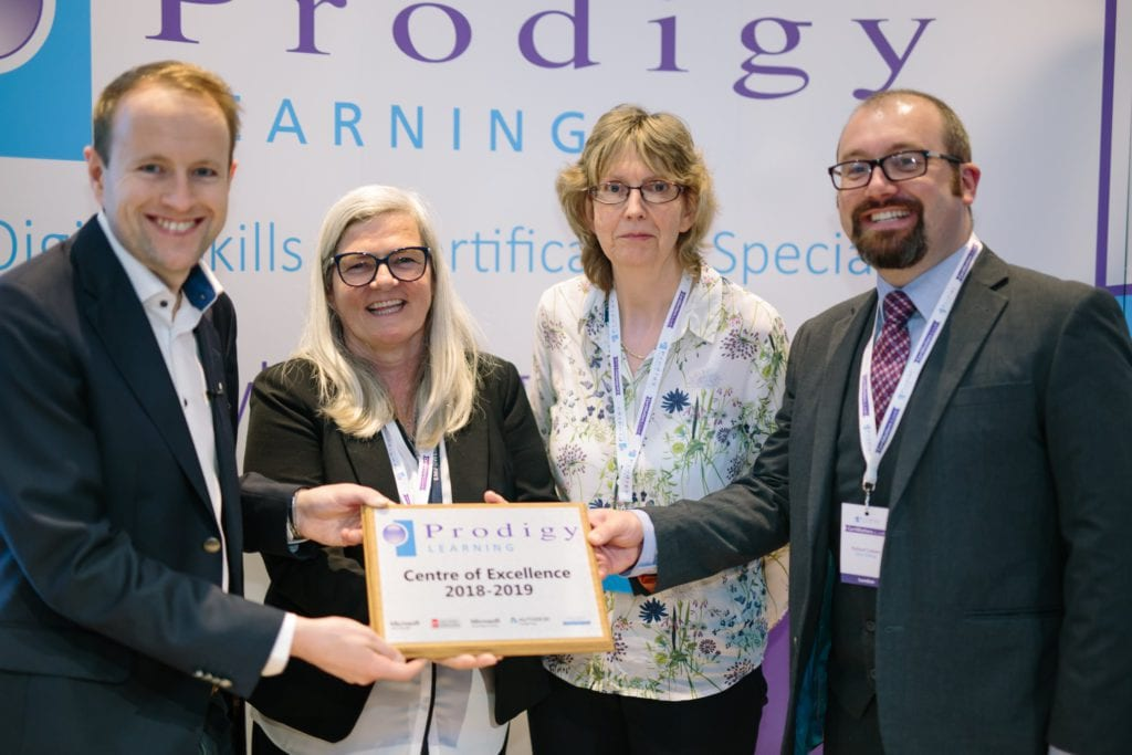Fiona Baxter, Louise Colverson and Richard Cottam recieving the Prodigy Centre of Excellence 2018 - 2019 Award