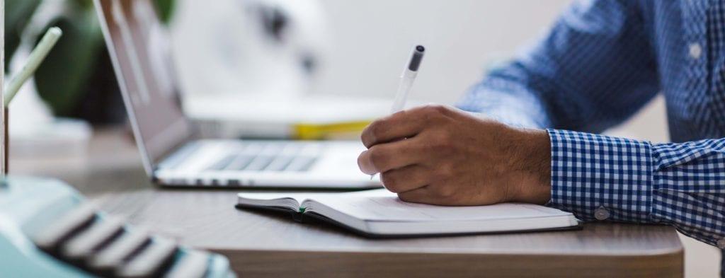 Taking notes on desk